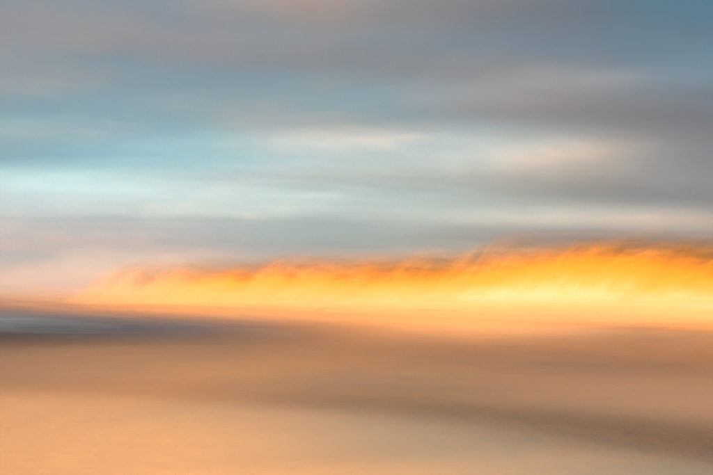 An abstract image of a sunset on a beach.